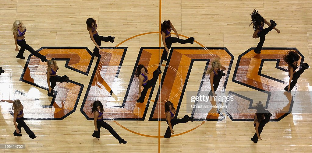 Phoenix Suns cheerleaders perform during the NBA game against the Chicago Bulls at US Airways Center on November 14, 2012 in Phoenix, Arizona. The Bulls defeated the Suns 112-106 in overtime.