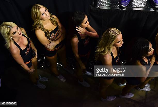 Phoenix Suns cheerleaders prepare to dance during an NBA Global Games match against the Dallas Mavericks at the Mexico City Arena on January 12 in...