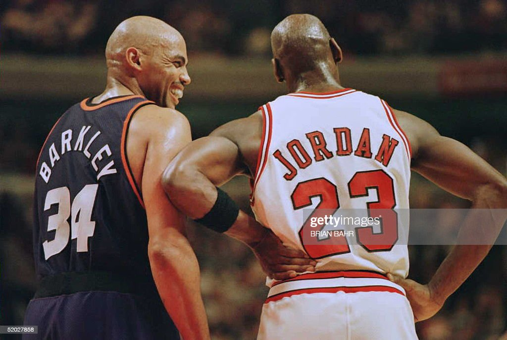 Phoenix Suns forward Charles Barkley (34) laughs at a foul call with Chicago Bulls guard <a gi-track='captionPersonalityLinkClicked' href=/galleries/search?phrase=Michael+Jordan+-+Basketball+Player&family=editorial&specificpeople=73625 ng-click='$event.stopPropagation()'>Michael Jordan</a> (23) in the first half 28 January 1996 at the United Center in Chicago. The Bulls won 93-82. Jordan scored 31 points, and Barkley scored 20 with 16 rebounds.