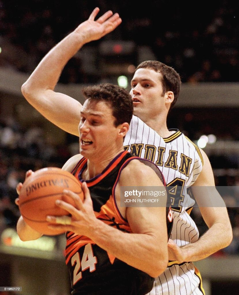 Phoenix Suns forward Tom Gugliotta 24 grabs a re