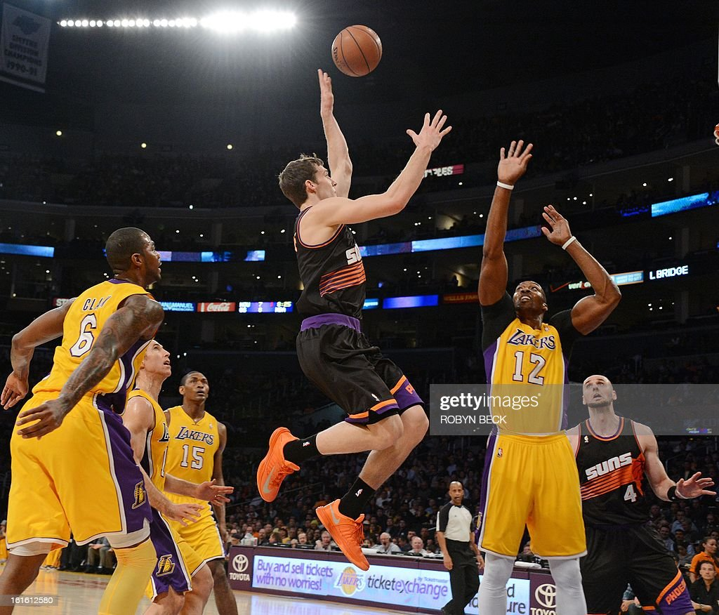 Phoenix Suns Goran Drajic (C) drives to the basket against the Los Angeles Lakers in their NBA basketball match at Staples Center in Los Angeles, California, February 12, 2013