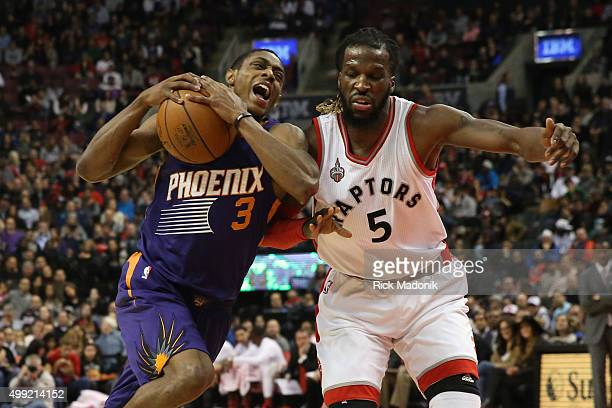 Phoenix Suns guard Brandon Knight drives against Toronto Raptors forward DeMarre Carroll Toronto Raptors vs Phoenix Suns in 1st half action of NBA...