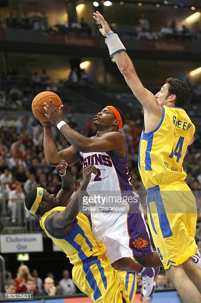 Phoenix Suns' Marcus Banks center challenged by Yaniv Green right and Will Bynum left of Maccabi Elite Tel Aviv during a NBA Live Tour basketball...