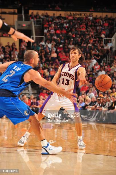 Phoenix Suns point guard Steve Nash and Dallas Mavericks point guard Jason Kidd fight for the ball control during the game against the Dallas...