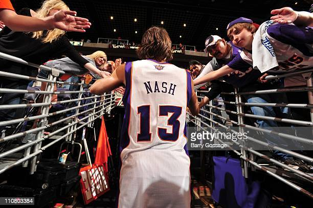 Phoenix Suns point guard Steve Nash greets fans during the game against the Toronto Raptors March 23 2011 at US Airways Center in Phoenix Arizona The...