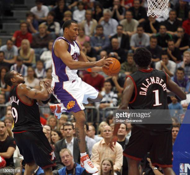 Phoenix Suns Shawn Marion central plays the ball against Andre Iguodala left and Samuel Dalambert of Philadelphia 76ers during a NBA Live Tour...