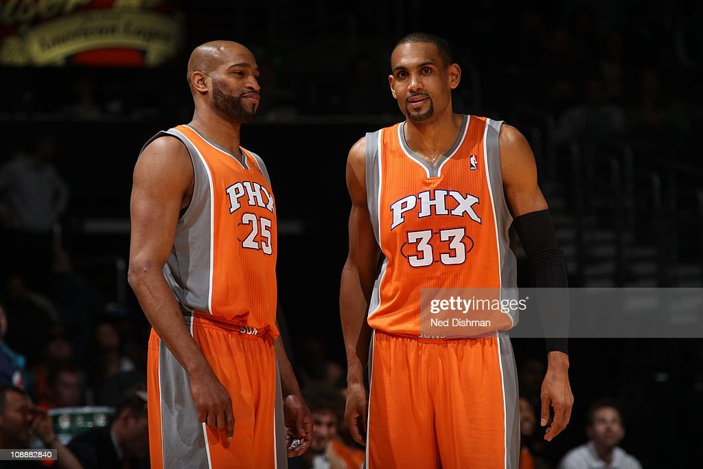 Phoenix Suns shooting guard <a gi-track='captionPersonalityLinkClicked' href=/galleries/search?phrase=Vince+Carter&family=editorial&specificpeople=201488 ng-click='$event.stopPropagation()'>Vince Carter</a> #25 and Phoenix Suns small forward <a gi-track='captionPersonalityLinkClicked' href=/galleries/search?phrase=Grant+Hill+-+Basketball+Player&family=editorial&specificpeople=201658 ng-click='$event.stopPropagation()'>Grant Hill</a> #33 confer during the game against the Washington Wizards at the Verizon Center on January 21, 2011 in Washington, DC. The Suns won 109-91.