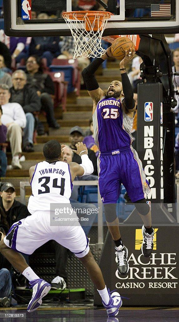 Phoenix Suns shooting guard Vince Carter shoots over Sacramento Kings center Jason Thompson in the first half at Arco Arena in Sacramento California...