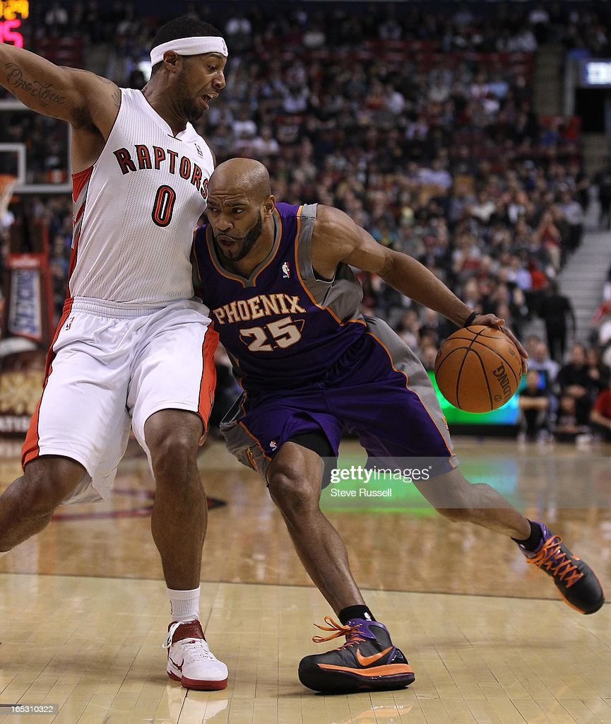 Phoenix Suns shooting guard Vince Carter works around Toronto Raptors small forward James Johnson as the Toronto Raptora play the Phoenix Suns at the...