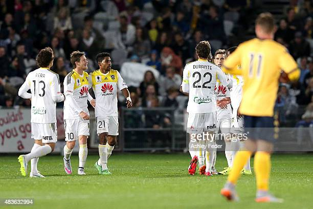 Phoenix team mates celebrate a goal by Kwabena Appiah during the FFA Cup match between Central Coast Mariners and Wellington Phoenix at Central Coast...