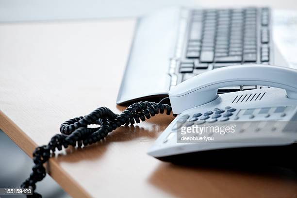 Phone and keyboard on desktop