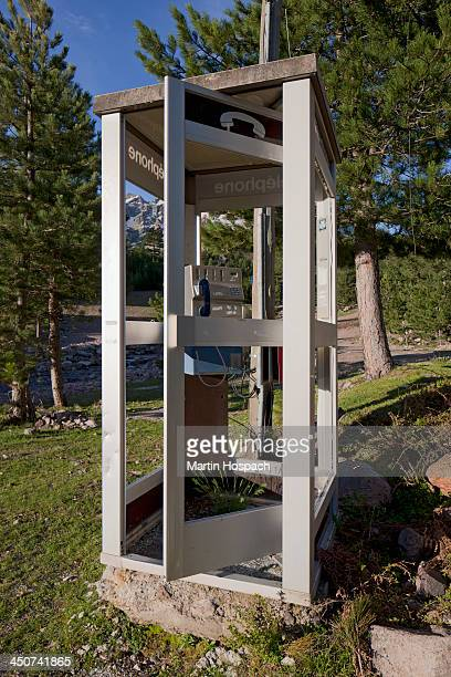 A phone booth in a remote location in nature