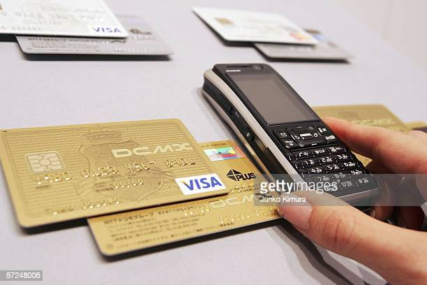 A phone equipped for NTT DoCoMo's new mobile phonebased credit card service is displayed during a press conference on April 4 2006 in Tokyo Japan...
