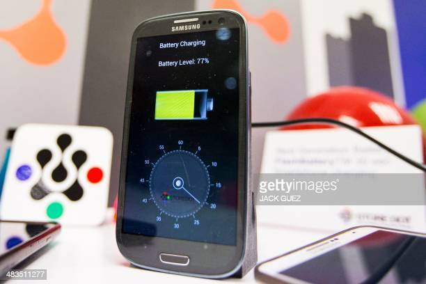 A phone is charged during a demonstration by Israeli startup StoreDot of a bioorganic charger system which they are developing that can recharge a...