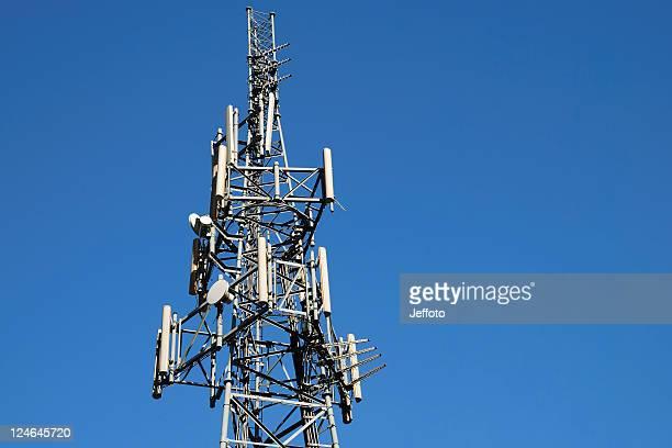 Phone mast against blue sky