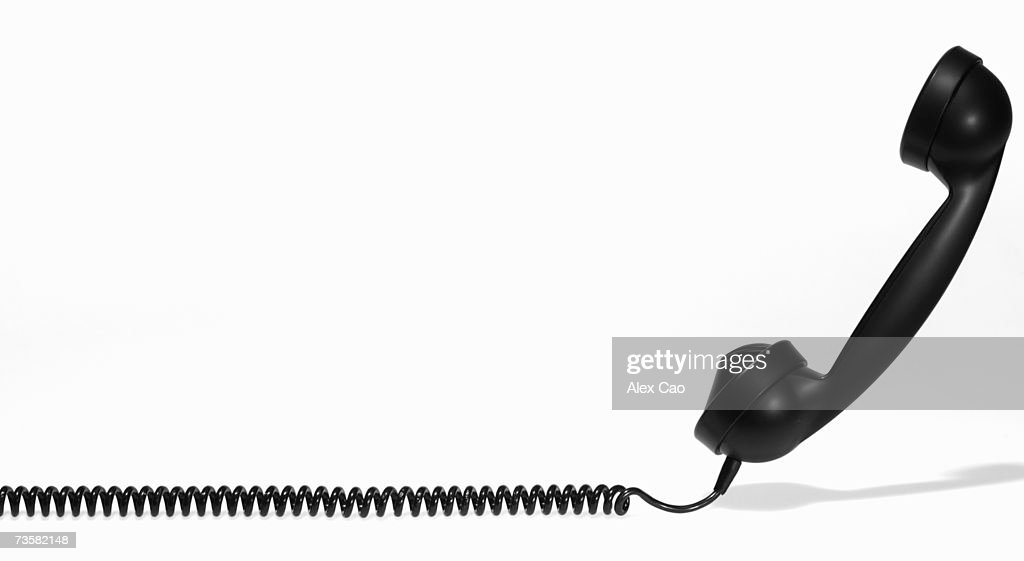 Phone receiver and cord, side view : Stock Photo