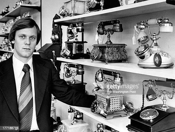 Phone store owner Carter Jones poses with his 150 models of home phones in Washington DC on May 13 1978