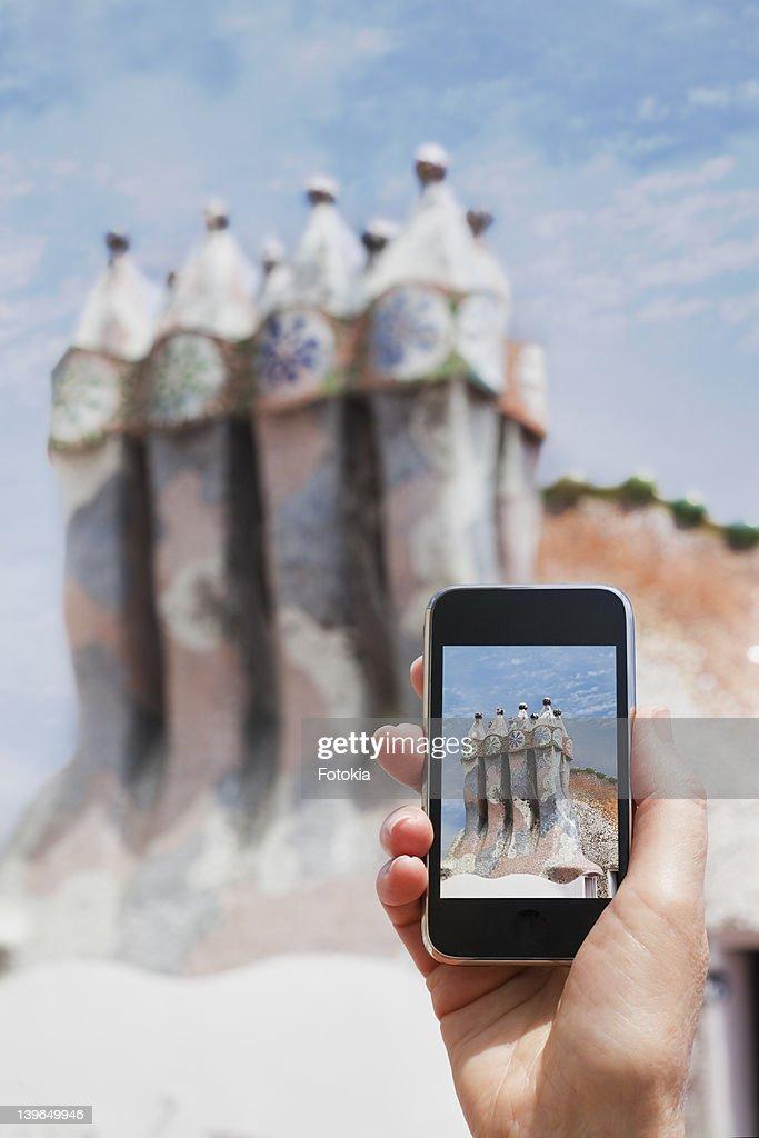 Phone with photo of Spanish architecture. : Stock Photo