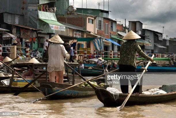 Phong Dien floating market Mekong Delta Vietnam The floating market of Phong Dien on the Hua River in the Mekong Delta of Vietnam