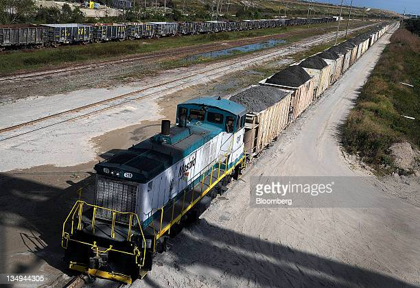 Phosphate rock loaded into railroad cars is ready to be transported to the Mosaic Co fertilizer chemical plant in Tampa Florida US on Friday Dec 2...