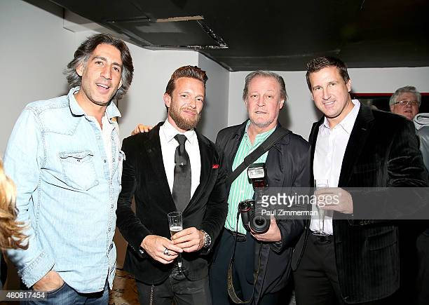 Photgraphers Dimitrios Kambouris Jamie McCarthy Patrick McMullan and Dave Kotinsky attend a pet portrait exhibition by Getty Images staff...