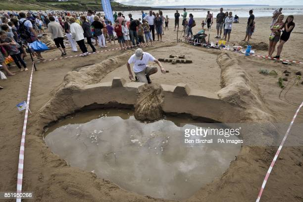 Photo A Dambusters sandcastle sculpture is near completion on Croyde beach Devon where the UK National Sandcastle competition is being held to raise...