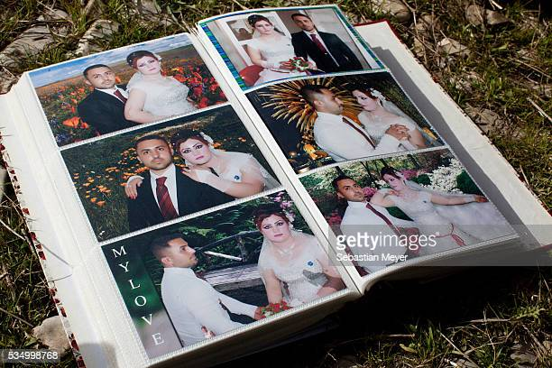 A photo album of wedding pictures of Zaydoon and his wife Hayam Jamal a Yezidi boy from Sinjar lives with his displaced family next to an oil...