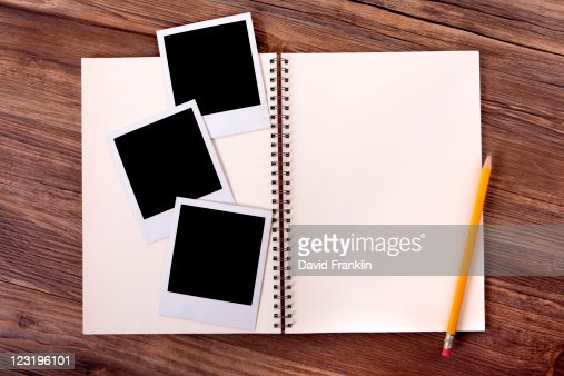 Photo album with blank photo prints : Stock Photo