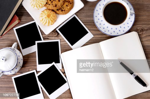 Photo album with coffee and biscuits : Stock Photo