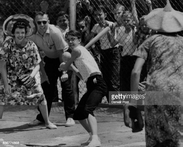 MAY 18 1961 MAY 24 1961 photo at right Rita Marx of 665 Martindaie Dr waits for pitch from Mrs Jean Torscher 2507 S Pennsylvania St Catching is Mrs...