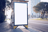 Photo blank lightbox on the bus stop in the modern city. Horizontal mockup