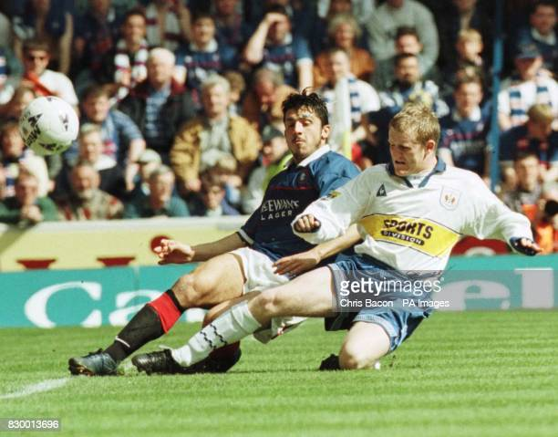 Kilmarnock's Mark Roberts and Rino Gattuso try to keep the ball in play during today's Bell's Scottish League clash at Ibrox today Final score...