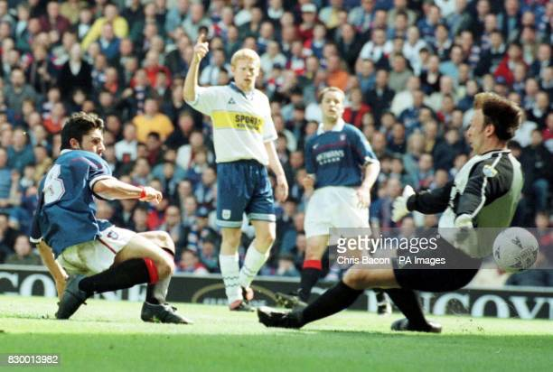 Ranger's Rino Gattuso puts the ball past the Kilmarnock keeper Gordon Marshall but is offsideduring today's Bell's Scottish League clash at Ibrox...