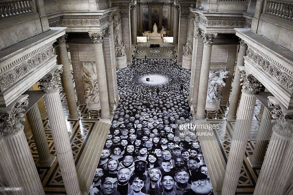 A photo by French photographer JR is displayed on the ground of the Pantheon in Paris, a secular temple which contains the remains of distinguished French citizens, on June 3, 2014, during the exhibition 'Au Pantheon'. The Centre des Monuments Nationaux has chosen to commission contemporary artist JR to create a participatory work inspired by his INSIDE OUT project. AFP PHOTO MARTIN BUREAU RESTRICTED TO EDITORIAL USE, MANDATORY MENTION OF THE ARTIST UPON PUBLICATION, TO ILLUSTRATE THE EVENT AS SPECIFIED IN THE CAPTION