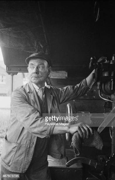 An engine driver on the footplate of the King Arthur class locomotive Sir Urre of the Mount on the Southern Railway southern England 1944 The train...