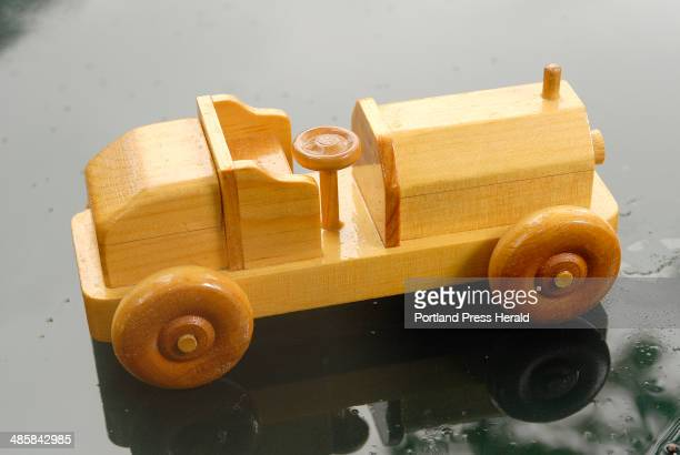 Photo by John Ewing/Staff Photographer Monday August 4 2008 Herbert Snyder has been making simple wooden toys like this toy car for years at his home...