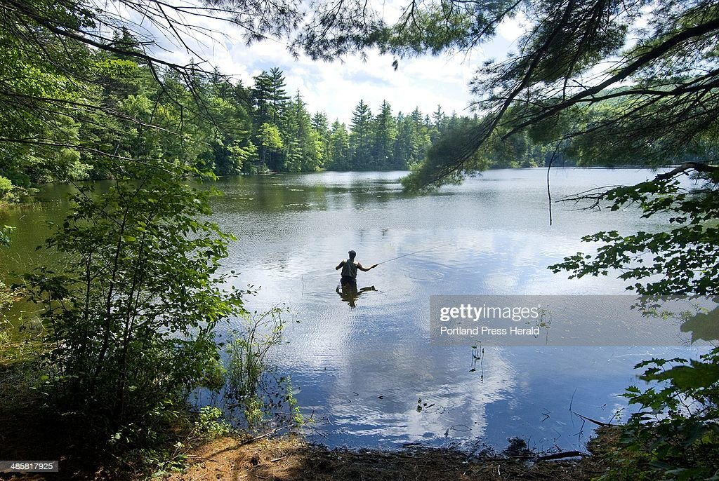 Photo by John Ewing/Staff Photographer Spencer Garrett of Portland does some fly casting near his campsite on Crocker Pond in the White Mountain...