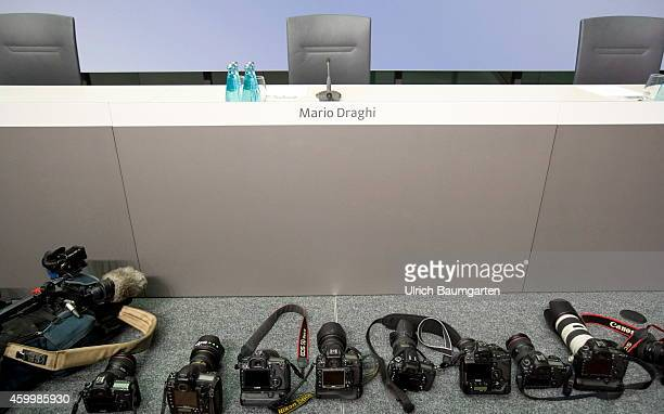 Photo cameras in front of the empty Draghi seat before the beginning of the monthly press conference of the European Central Bank in Frankfurt on...