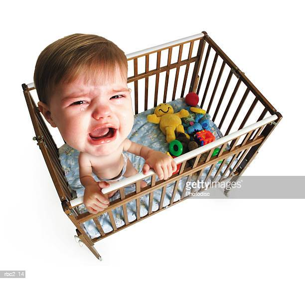 photo caricature from a birdseye view of a little baby crying in her crib