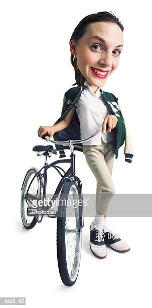 photo caricature of a young brunette caucasian woman in her boyfriends letterman jacket walks with her bicycle