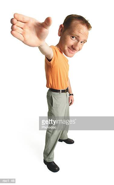photo caricature of a young caucasian male in an orange t-shirt stands smiling smugly as he raises his hand up into the air