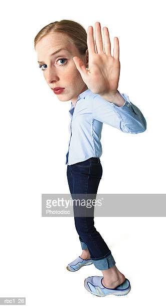 photo caricature of a young caucasian woman in a blue blouse and jeans raises up her hand in an act of annoyance