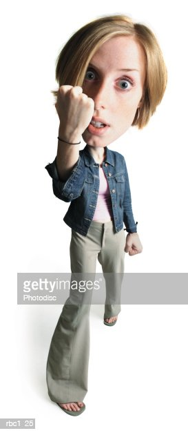 photo caricature of a young caucasian woman in tan pants and a jean jacket as she steps forward and raises a large fist : Stock Photo