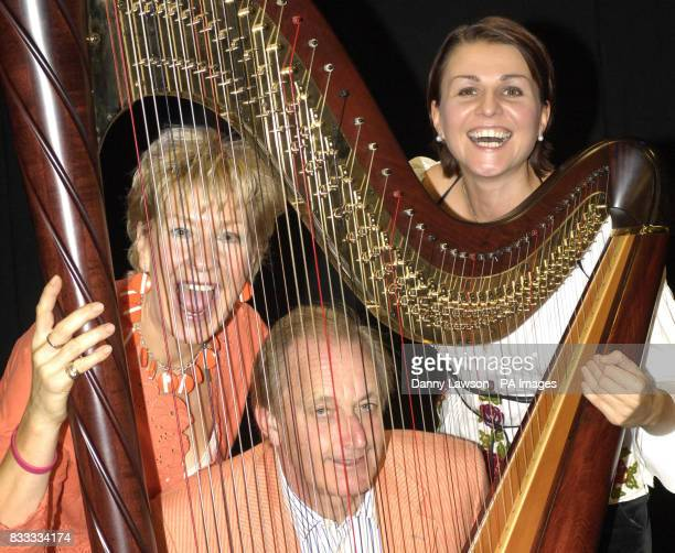 Photo Christine and Neil Hamilton with guest harpist Alina Bzhezhinska following their Edinburgh Fringe Festival show Lunch with the Hamiltons Second...