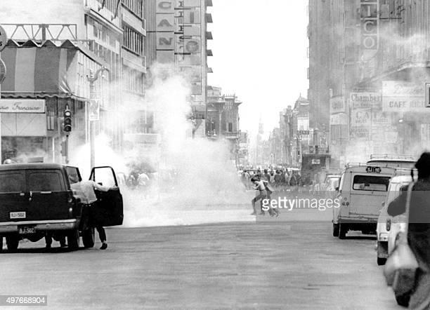 Photo datée octobre 1972 de l'affrontement entre grévistes opposés à la politique du président Salvador Allende et partisans de l'Union Populaire qui...