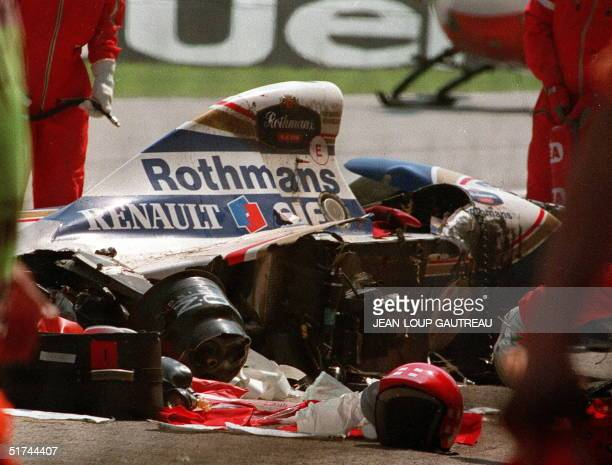 Photo dated 01MAY94 shows rescuers gathered around the remains of the Williams racing car after Brazilian Ayrton Senna's fatal crash at the San...