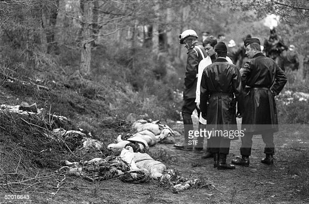 A photo dated 03 March 1974 of French officials looking at the corpses and the debris leftover from the DC10 Turkish Airlines airplane crash in the...
