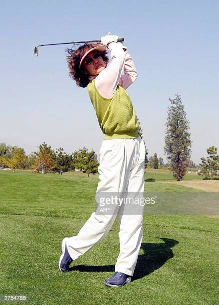 Photo dated 10 October 2003 shows a wealthy Chinese woman playing a round of golf at an exclusive golf club in the suburbs of Beijing In China golf...