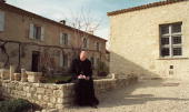 photo dated 13MAR92 shows an unidentified monk sitting outside the Benedictine monastery of Ganagobie founded in the time of Charlemagne and...