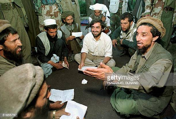 Photo dated 15 August 1997 shows Afghan Commander Ahmed Shah Masood gesturing while talking with his commanders in this village some 60 kilometres...